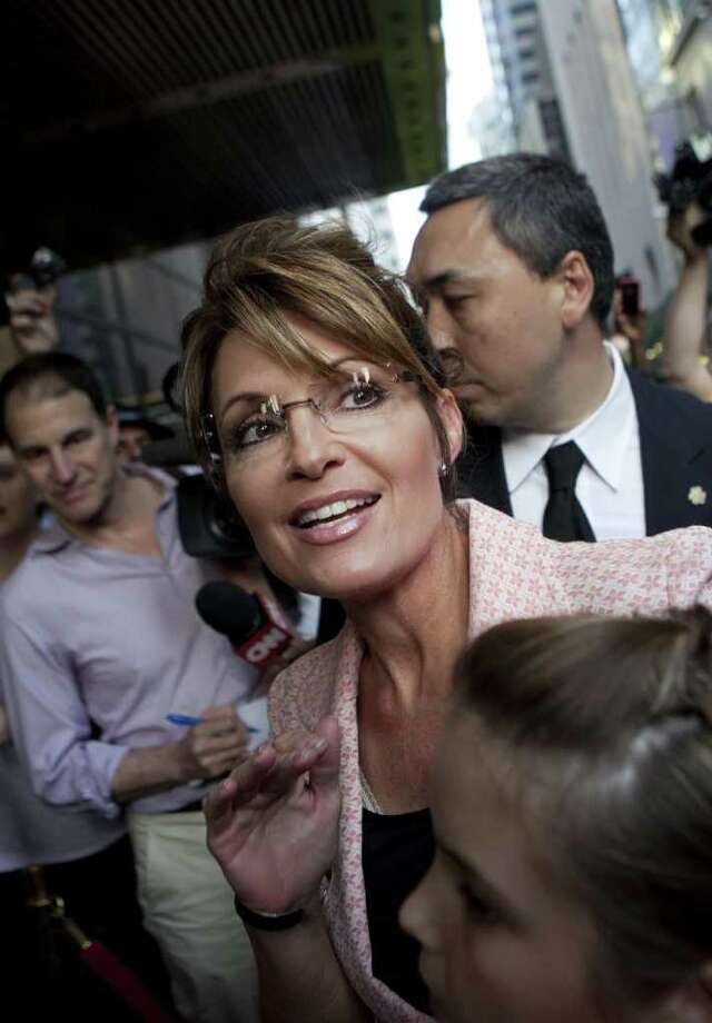 NEW YORK, NY - MAY 31:  Former U.S. Vice presidential candidate and Alaska Governor Sarah Palin walks past members of the media while arriving at Trump Tower on 56th Street and 5th Avenue on May 31, 2011 in New York City. Palin and Donald Trump later exited the building for dinner. Photo: Andrew Burton, Getty Images / 2011 Getty Images