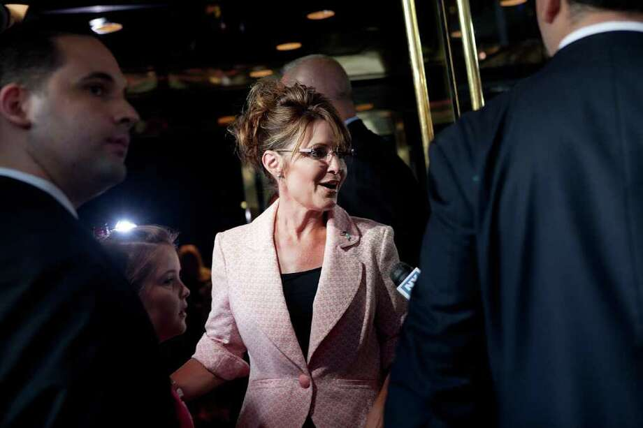 NEW YORK, NY - MAY 31:  Former U.S. Vice presidential candidate and Alaska Governor Sarah Palin answers questions from the media while arriving at Trump Tower on 56th Street and 5th Avenue on May 31, 2011 in New York City. Palin and Donald Trump later exited the building for dinner. Photo: Andrew Burton, Getty Images / 2011 Getty Images
