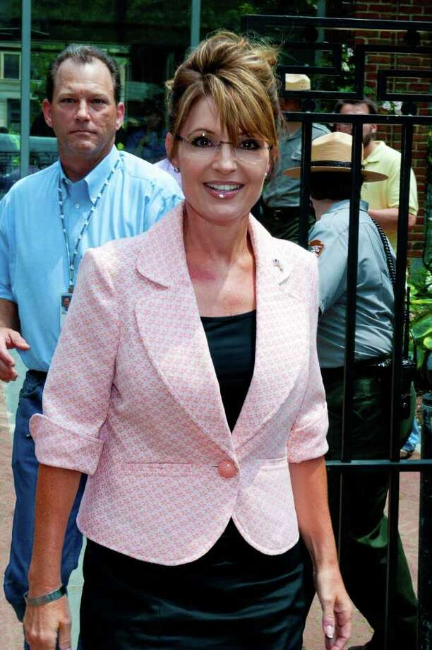 "PHILADELPHIA, PA - MAY 31: Sarah Palin leaves the Liberty Bell Center during her ""One Nation"" bus tour May 31, 2011 in Philadelphia, Pennsylvania. Palin is visiting American landmarks during the tour, although she is not informing the media as to where she is going, prompting many media outlets to follow her bus from place to place. Photo: Jeff Fusco, Getty Images / 2011 Getty Images"