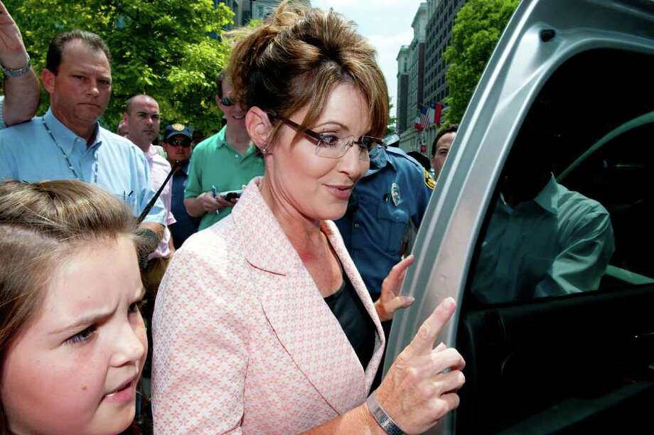 "PHILADELPHIA, PA - MAY 31: Sarah Palin (2nd R) leaves the Liberty Bell Center during her ""One Nation"" bus tour with her daughter Piper (L) on May 31, 2011 in Philadelphia, Pennsylvania. Palin is visiting American landmarks during the tour, although she is not informing the media as to where she is going, prompting many media outlets to follow her bus from place to place. Photo: Jeff Fusco, Getty Images / 2011 Getty Images"