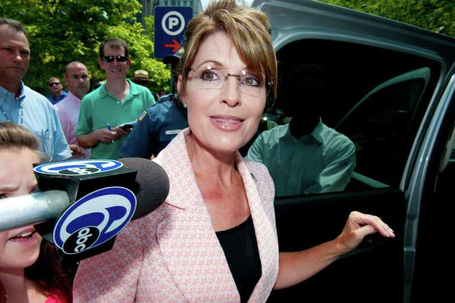 "PHILADELPHIA, PA - MAY 31: Sarah Palin (C) speaks with the press outside the Liberty Bell Center during her ""One Nation"" bus tour May 31, 2011 in Philadelphia, Pennsylvania. Palin is visiting American landmarks during the tour, although she is not informing the media as to where she is going, prompting many media outlets to follow her bus from place to place. Photo: Jeff Fusco, Getty Images / 2011 Getty Images"