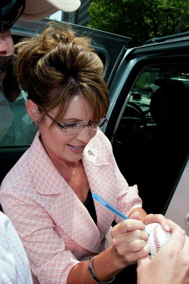"PHILADELPHIA, PA - MAY 31: Sarah Palin signs an aoutograph outside the Liberty Bell Center during her ""One Nation"" bus tour May 31, 2011 in Philadelphia, Pennsylvania. Palin is visiting American landmarks during the tour, although she is not informing the media as to where she is going, prompting many media outlets to follow her bus from place to place. Photo: Jeff Fusco, Getty Images / 2011 Getty Images"