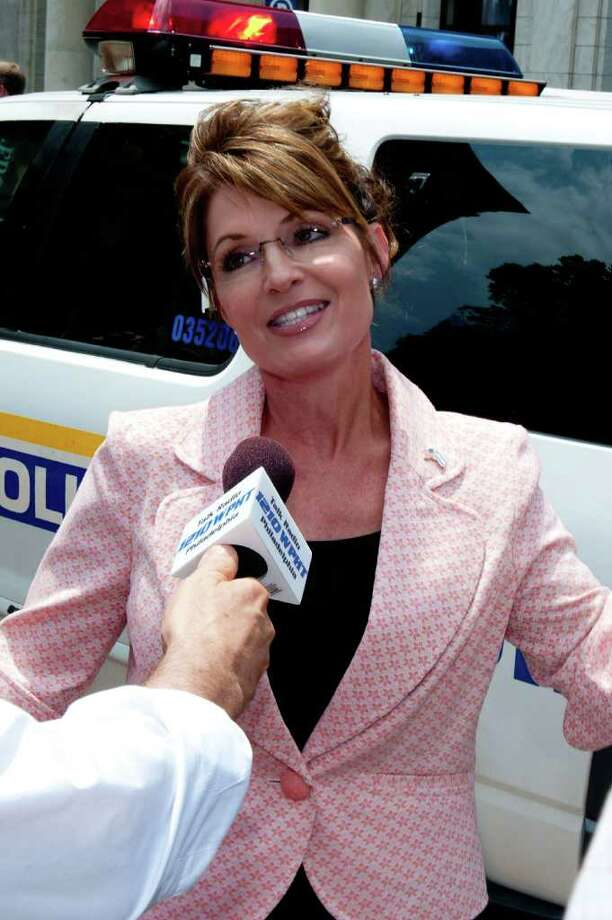 "PHILADELPHIA, PA - MAY 31: Sarah Palin speaks with the press outside the Liberty Bell Center during her ""One Nation"" bus tour May 31, 2011 in Philadelphia, Pennsylvania. Palin is visiting American landmarks during the tour, although she is not informing the media as to where she is going, prompting many media outlets to follow her bus from place to place. Photo: Jeff Fusco, Getty Images / 2011 Getty Images"