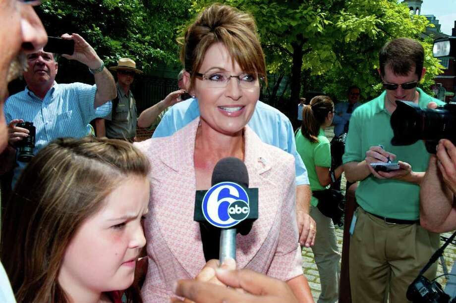 "PHILADELPHIA, PA - MAY 31: Sarah Palin (C) speaks with the press outside the Liberty Bell Center during her ""One Nation"" bus tour as her daughter Piper (L) looks on May 31, 2011 in Philadelphia, Pennsylvania. Palin is visiting American landmarks during the tour, although she is not informing the media as to where she is going, prompting many media outlets to follow her bus from place to place. Photo: Jeff Fusco, Getty Images / 2011 Getty Images"