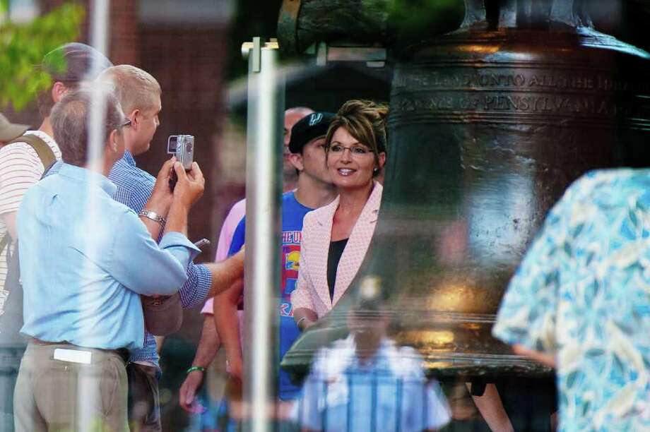 "PHILADELPHIA, PA - MAY 31: Sarah Palin stands next ot the the Liberty Bell as during her ""One Nation"" bus tour as her daughter Piper (2nd R) looks on May 31, 2011 in Philadelphia, Pennsylvania. Palin is visiting American landmarks during the tour, although she is not informing the media as to where she is going, promting many media outlets to follow her bus from place to place. Photo: Jeff Fusco, Getty Images / 2011 Getty Images"