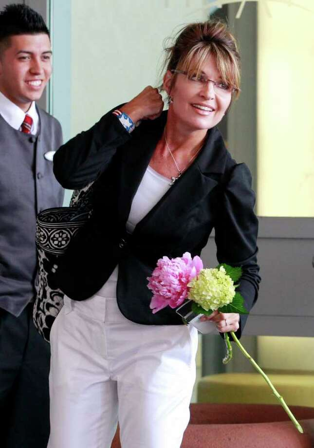Former Alaska Gov. Sarah Palin exits the Hyatt Regency Hotel, Wednesday, June 1, 2011 in Jersey City, N.J. Photo: Julio Cortez, AP / AP