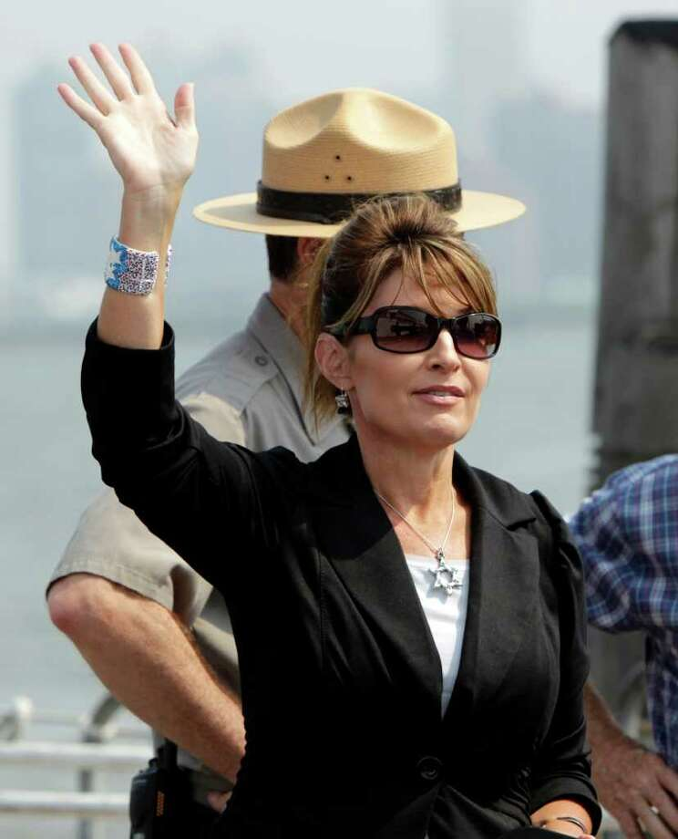 Sarah Palin waves to visitors on a ferry as she leaves Liberty Island in New York, Wednesday, June 1, 2011. Photo: Seth Wenig, AP / AP