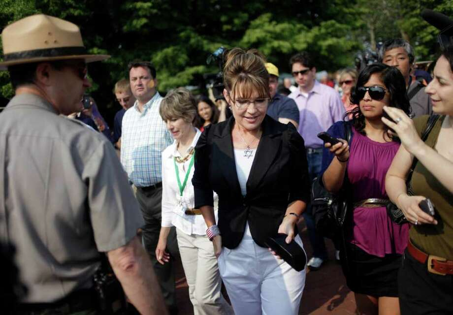 Sarah Palin talks to the media as she visits LIberty Island in New York, Wednesday, June 1, 2011. Photo: Seth Wenig, AP / AP