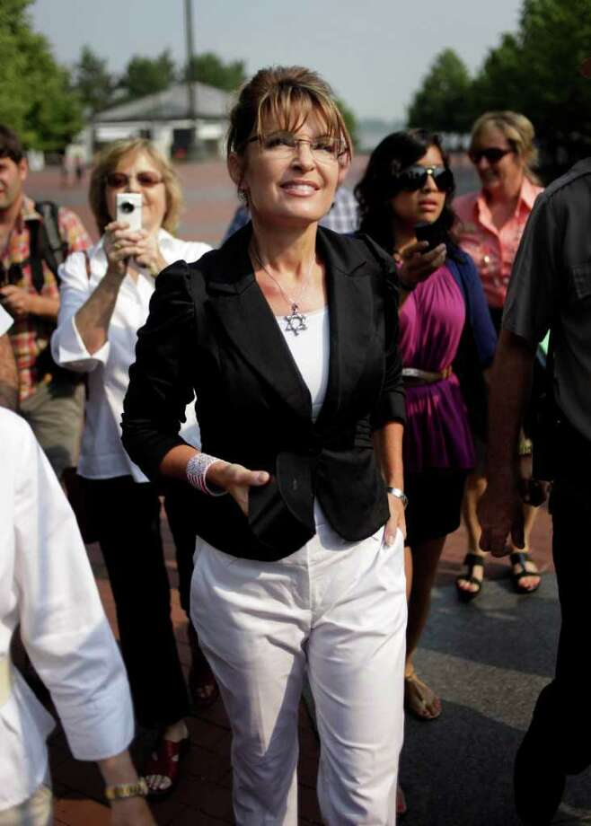 Sarah Palin looks up as she approaches the Statue of Liberty on Liberty Island in New York, Wednesday, June 1, 2011. Photo: Seth Wenig, AP / AP