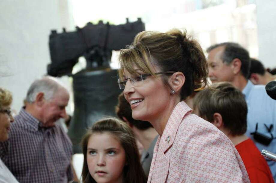 Sarah Palin, former GOP vice presidential candidate and Alaska governor, accompanied by daughter Piper Palin, meets with people in view of the Liberty Bell at Independence National Historical Park Tuesday, May 31, 2011, in Philadelphia. Palin's website posted a photograph Tuesday of her in a coffee shop in Dillsburg following her overnight stay at a hotel at the Civil War battlefield in southern Pennsylvania. The stops are part of a secretive bus trip to historic sites that has observers questioning whether it's really a bid to drum up publicity for a 2012 presidential run. Photo: Matt Rourke, AP / AP