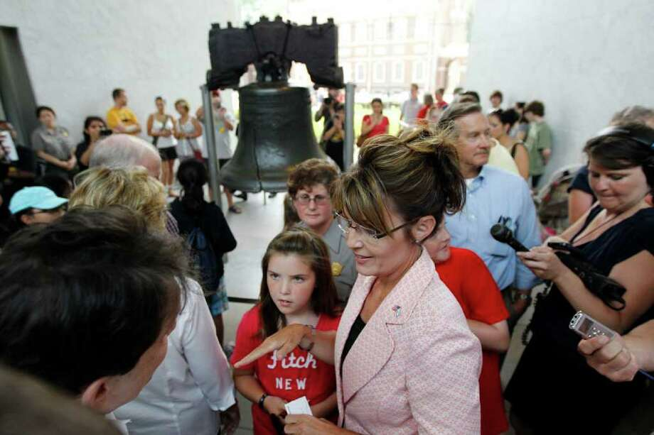 Sarah Palin, former GOP vice presidential candidate and Alaska governor, accompanied by daughter Piper Palin, meets with people in view of the Liberty Bell at Independence National Historical Park Tuesday, May 31, 2011, in Philadelphia. Photo: Matt Rourke, AP / AP