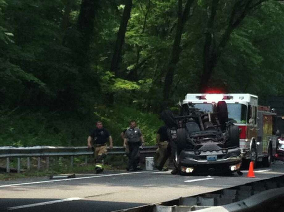 Emergency officials respond to a double rollover accident on the northbound Merritt Parkway in New Canaan, Conn. on Wednesday, June 1, 2011. Photo: John Nickerson / Stamford Advocate