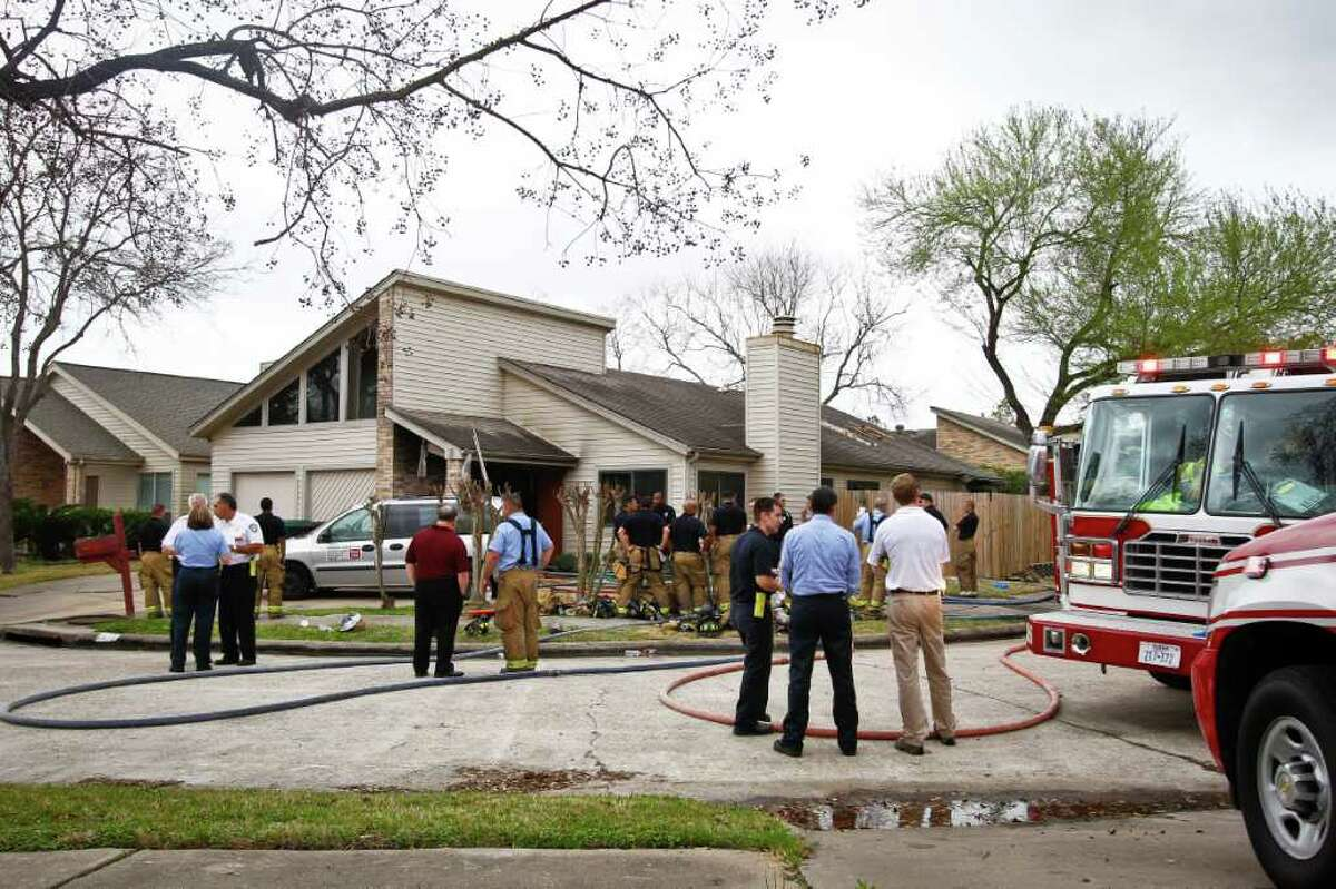 Emergency personnel respond to the location where a fire broke out at a day care operated by Jessica Tata on Feb. 24 in Houston.