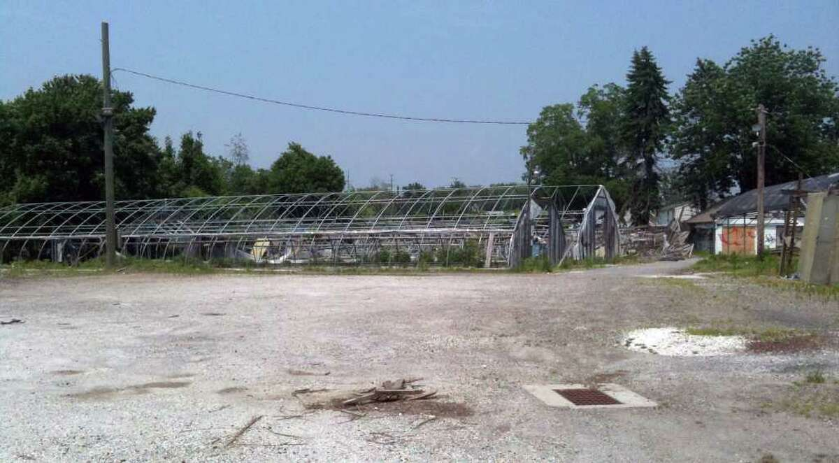 The old Agriventure Agway site at 376 Danbury Road is in disrepair after the winter. DOT, the property owner, says it is not their concern.