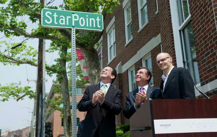 Gov. Dannel P. Malloy, Stamford Mayor Michael Pavia and Frits van Paasschen, president and CEO Starwood Hotels & Resorts, stand at the podium after Starwood's 'street renaming' ceremony to celebrate their move to 333 Ludlow Street in Stamford, Conn. on Wednesday June 1, 2011. Photo: Kathleen O'Rourke / Stamford Advocate