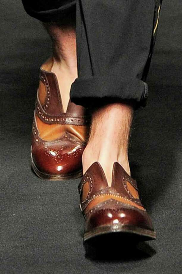 Edgy wingtips with a slashed opening and in shades of rust and brown from Miharayashuhio for spring and summer 2011