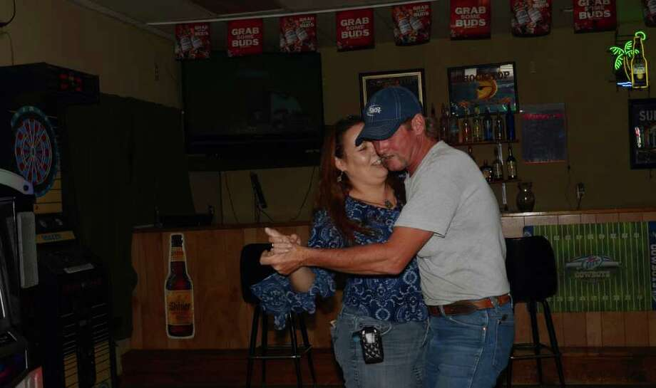 Cory Dodd shows Debbie Collins some dance moves round the juxebox at Nellie's Tavern 13. ROBIN JOHNSON / SPECIAL TO THE EXPRESS-NEWS