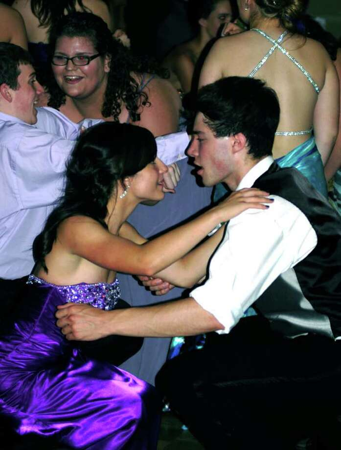 """SPECTRUM/Adrienne Fednya-Dembeck and Jesse Steinmetz go low while dancing to the iconic """"You Make Me Want To Shout"""" at the Shepaug Valley High School  Junior Prom, May 28, 2011 at the Crowne Plaza in Southbury. Photo: Norm Cummings / The News-Times"""