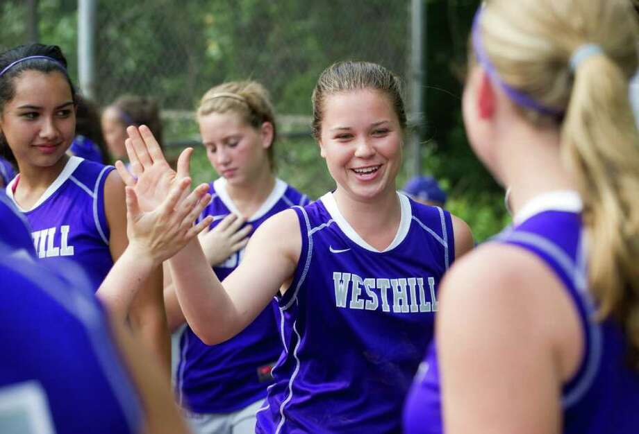 Westhill's Morgan Kurtz is congratulated by teammates after bringing in a run as Westhill High School hosts Pomperaug in a Class LL softball game in Stamford, Conn.,  June 1, 2011. Photo: Keelin Daly / Stamford Advocate