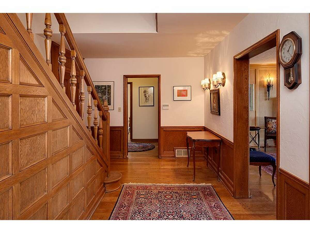 Entry, showing old paneling, pegged-plank floors and fixtures.