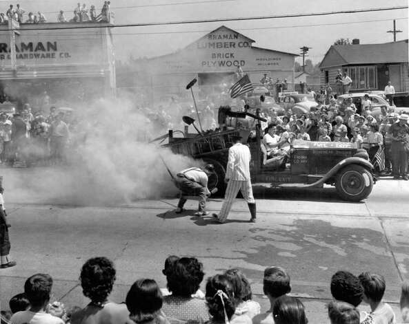 A show during Lake City Pioneer Days, July 1950. The lumber and hardware company of Dorm Braman, who went on to be mayor of Seattle mayor in the 1960s, is seen in back with spectators on the roof. That site is now home to Chase Bank and Claire's Parnty. Photo: Seattlepi.com File