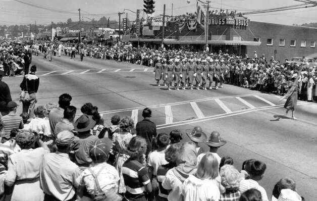 A July 1950 Pioneer Days parade photo looking north in what's now the 12300 block of Lake City Way Northeast. Lake City Drugs is on the northeast corner, which is now where the Rekhi Building stands. Photo: Seattlepi.com File