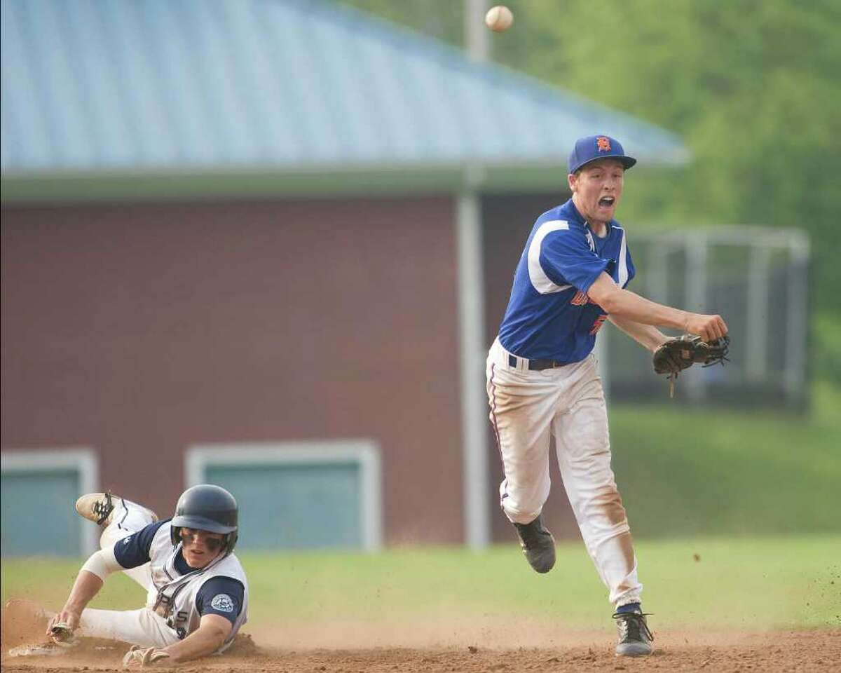 Danbury's Robbie Meerman, after pitching six innings, moved to shortstop in the seventh and turned a double play against Staples in the Class LL state tournament second round game Wednesday at Danbury High School.