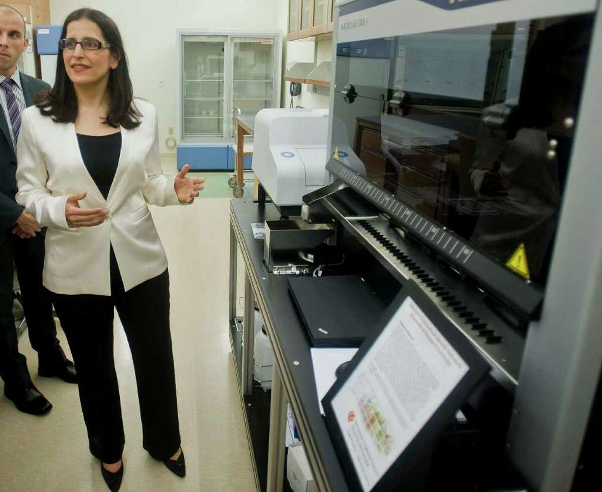 Dr. Shohreh Shahabi, chairman of the Danbury Hospital Reproductive Tumor Biology Labratory, discusses the Proteomic Platform machine at the new Danbury Hospital Research Institute on West Street. The device studies protein-to-protein interaction. Wednesday, June 1, 2011