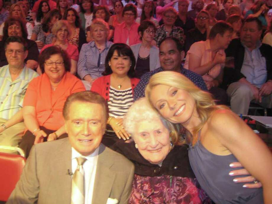 """Nathaniel Witherell nursing home resident Helen Weisner poses for a photo with Regis Philbin and Kelly Ripa during a commercial break for """"Live! With Regis and Kelly"""" on Wednesday, June 1, 2011. In April, the Greenwich police union won tickets to a taping of """"Live! With Regis and Kelly,"""" in a raffle that benefitted the nursing home, and the officers decided to invite Weisner, 96, who had picked the winning ticket. Photo: Contributed Photo / Greenwich Time Contributed"""