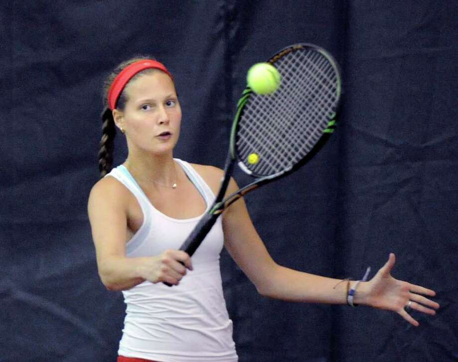 Michelle Vogt of Greenwich High School in doubles action during the girls high school Class L tennis playoff match between Greenwich High School and Staples High School at Sound Shore Indoor Tennis, Port Chester, N.Y., Wednesday afternoon, June 1, 2011. Photo: Bob Luckey / Greenwich Time