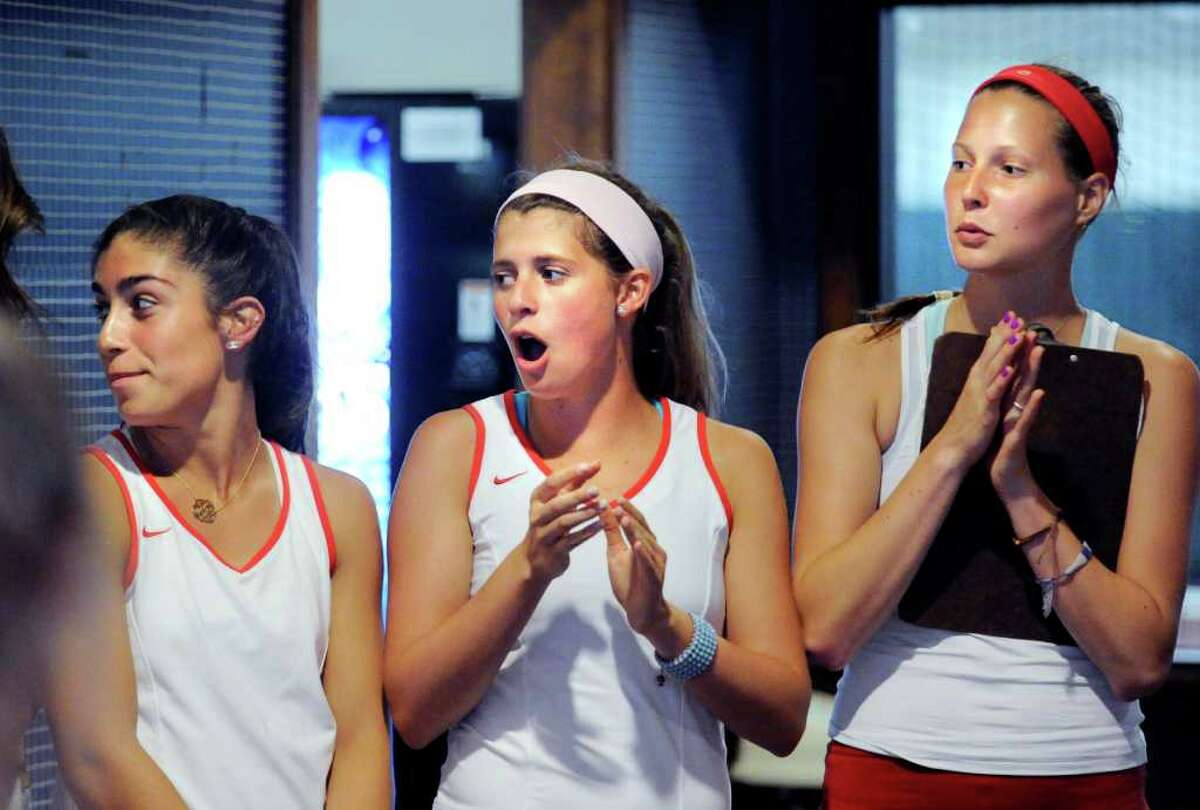 Left to right, Jen DeLuca, Katey Hopper and Michelle Vogt, all of the Greenwich High School girls tennis team cheer during introductions before the girls high school Class L tennis playoff match between Greenwich High School and Staples High School at Sound Shore Indoor Tennis, Port Chester, N.Y., Wednesday afternoon, June 1, 2011.