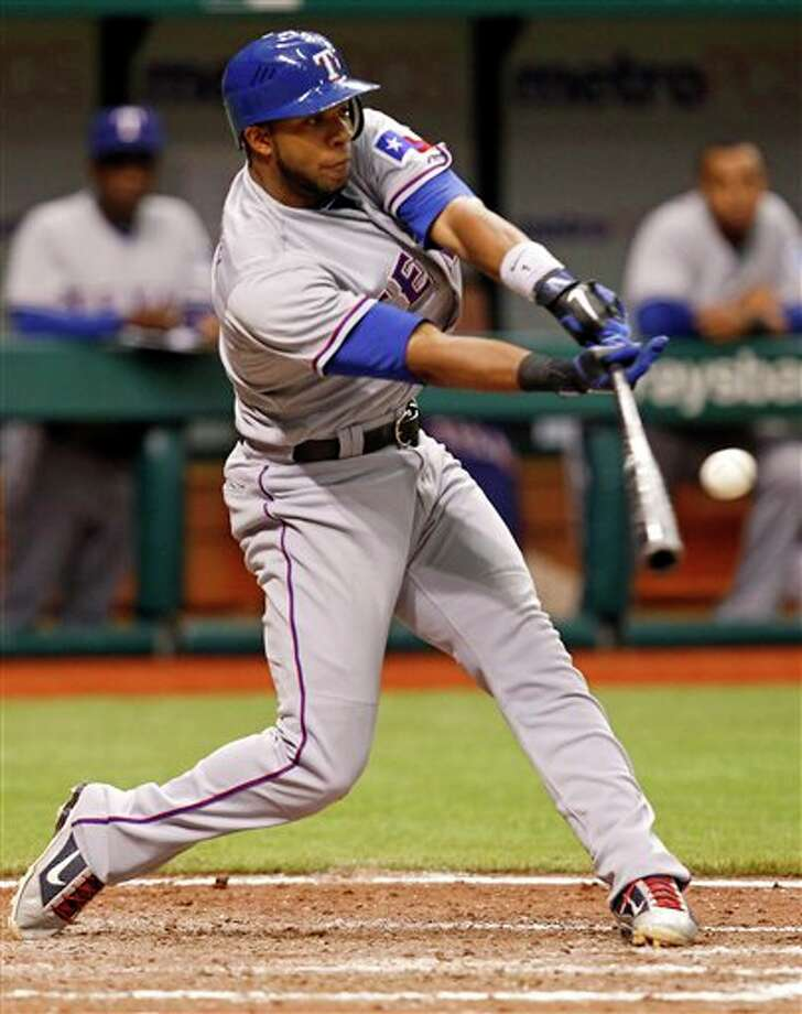 The Rangers' Elvis Andrus hits a two-RBI single in the eighth inning against the Rays on Wednesday, June 1, 2011, in St. Petersburg, Fla. MIKE CARLSON/ASSOCIATED PRESS Photo: Associated Press