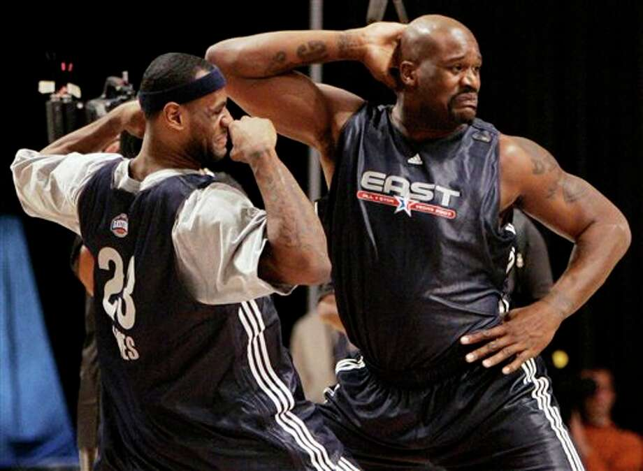 "This Feb. 17, 2007, file photo, shows Shaquille O'Neal, right, of the Miami Heat, and LeBron James, of the Cleveland Cavaliers,  dancing together during NBA All-Star basketball practice in Las Vegas.  O'Neal says on Twitter, Wednesday, June 1, 2011,  that he's ""about to retire.""(AP Photo/Kevork Djansezian, File) Photo: Associated Press"