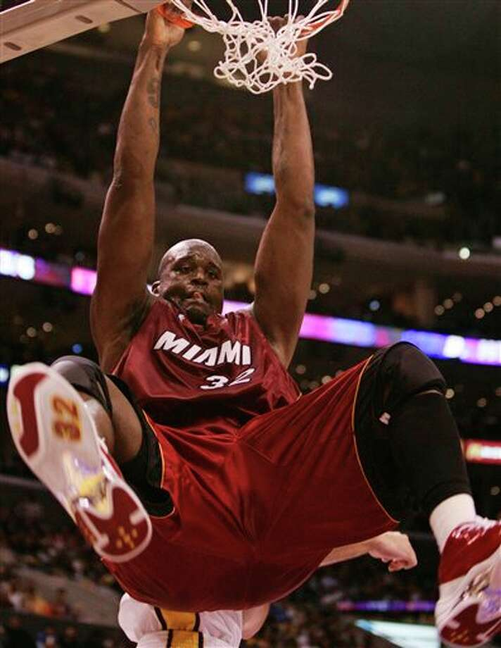 "This Dec. 25, 2004, file photo shows Miami Heat's Shaquille O'Neal dunking the ball during the first half against the Los Angeles Lakers, in Los Angeles.  O'Neal says on Twitter that he's ""about to retire.""(AP Photo/Kevork Djansezian, Filer) Photo: Associated Press"