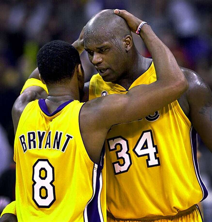"This April 21, 2002 file photo shows Los Angeles Lakers's Kobe Bryant, left, and Shaquille O'Neal embracing in the closing minutes in Game 1 of their best-of-five first-round Western Conference playoff series against the Portland Trail Blazers in Los Angeles.  O'Neal says on Twitter  Wednesday June 1, 2011,that he's ""about to retire."" O'Neal sent a Tweet shortly before 2:45 p.m. saying, ""im retiring."" It included a link to a 16-second video in which he says, ""We did it; 19 years, baby. Thank you very much. That's why I'm telling you first: I'm about to retire. Love you. Talk to you soon."" (AP Photo/Mark J. Terrill,File) Photo: Associated Press"