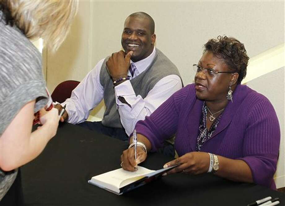 "This March 31, 2010 file photo shows Cleveland Cavaliers center Shaquille O'Neal and his mother, Lucille O'Neal, signing copies of her book, ""Walk Like You Have Somewhere to Go: From Mental Welfare to Mental Wealth,"" for fans prior to the Cavaliers' NBA basketball game in Cleveland. O'Neal says on Twitter  Wednesday June 1, 2011, that he's ""about to retire."" O'Neal sent a Tweet shortly before 2:45 p.m. saying, ""im retiring."" It included a link to a 16-second video in which he says, ""We did it; 19 years, baby. Thank you very much. That's why I'm telling you first: I'm about to retire. Love you. Talk to you soon."" (AP Photo/Ron Schwane,File) Photo: Associated Press"
