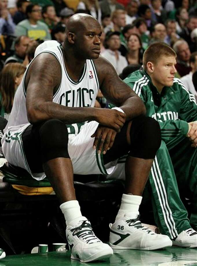 "This Oct. 29, 2010 file photo shows Boston Celtics center Shaquille O'Neal sitting on the bench with teammates during the second half of Boston's 105-101 win against the New York Knicks in a NBA basketball game in Boston. O'Neal says on Twitter that he's ""about to retire."" O'Neal sent a Tweet shortly before 2:45 p.m. saying, ""im retiring."" It included a link to a 16-second video in which he says, ""We did it; 19 years, baby. Thank you very much. That's why I'm telling you first: I'm about to retire. Love you. Talk to you soon.""  (AP Photo/Winslow Townson,File) Photo: Associated Press"