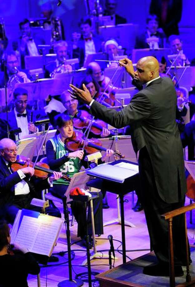 "This Dec. 20, 2010, file photo shows Boston Celtics' center Shaquille O'Neal serving as guest conductor of the Boston Pops Orchestra during a holiday concert at Symphony Hall in Boston,  O'Neal says on Twitter, Wednesday, June 1, 2011,  that he's ""about to retire."" (AP Photo/Gretchen Ertl, File) Photo: Associated Press"