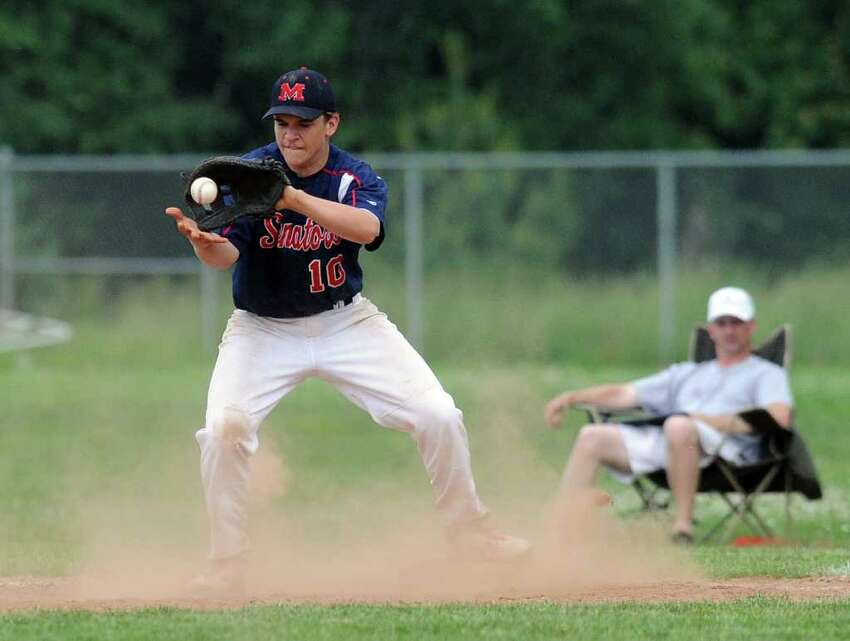 McMahon's Joseph Cox makes a catch during Wednesday's Class LL baseball game at Brien McMahon High School on June 1, 2011.
