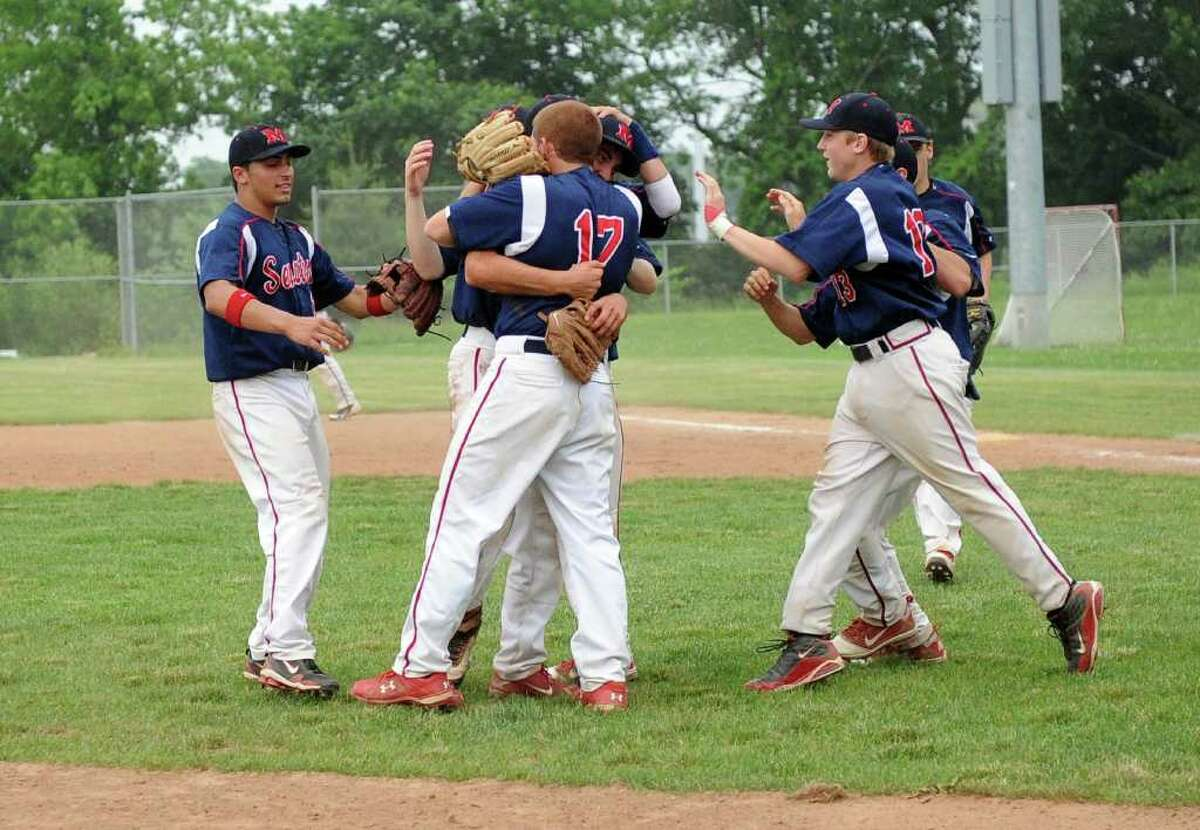 McMahon's players celebrate their win after Wednesday's Class LL baseball game at Brien McMahon High School on June 1, 2011.