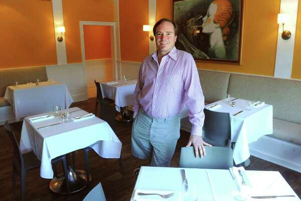 Owner Jamie Cooper poses for a portrait in the dining room of Bonda Restaurant in Fairfield.
