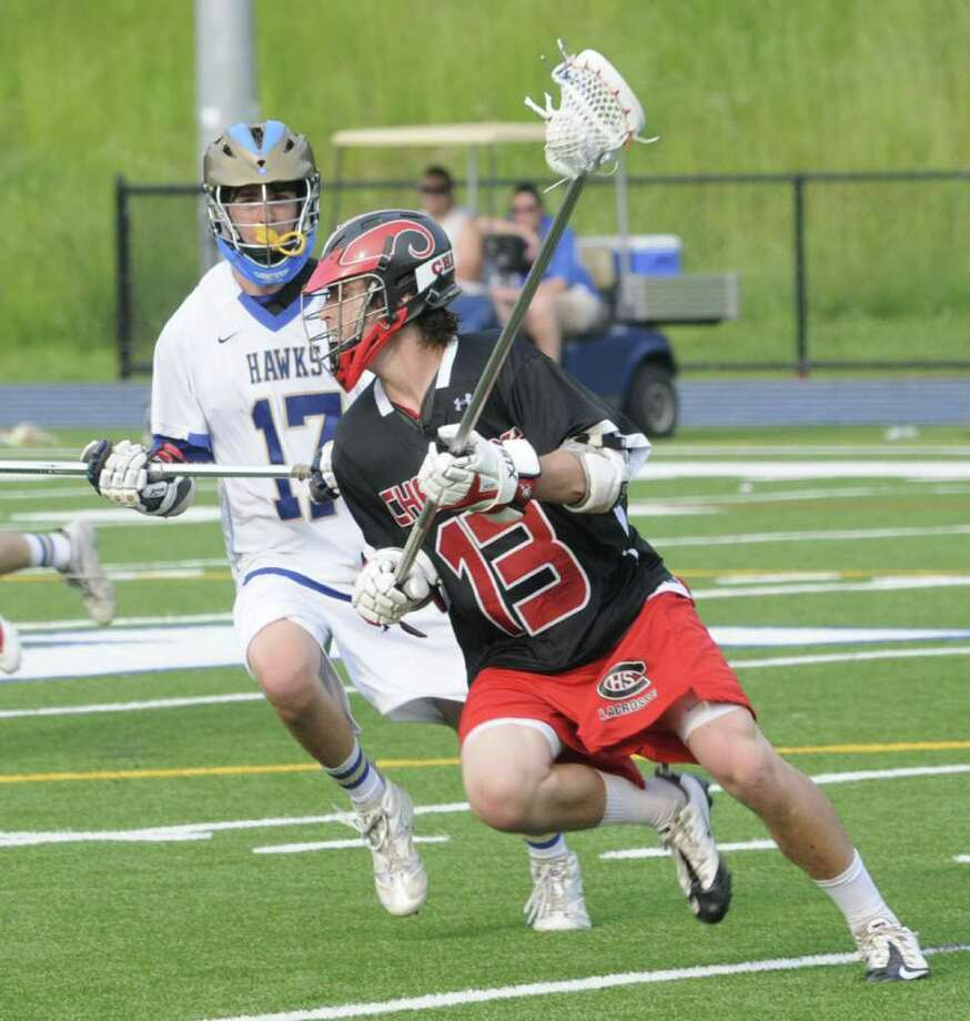Evan Gaudio, #13, of Cheshire High School, races toward the goal, against, Jack Kearney, #17, of Newtown High School,  during a SWC first round Class L boys lacrosse game,  in Newtown, on Wednesday, June 1, 2011. Photo: Jay Weir / The News-Times Freelance