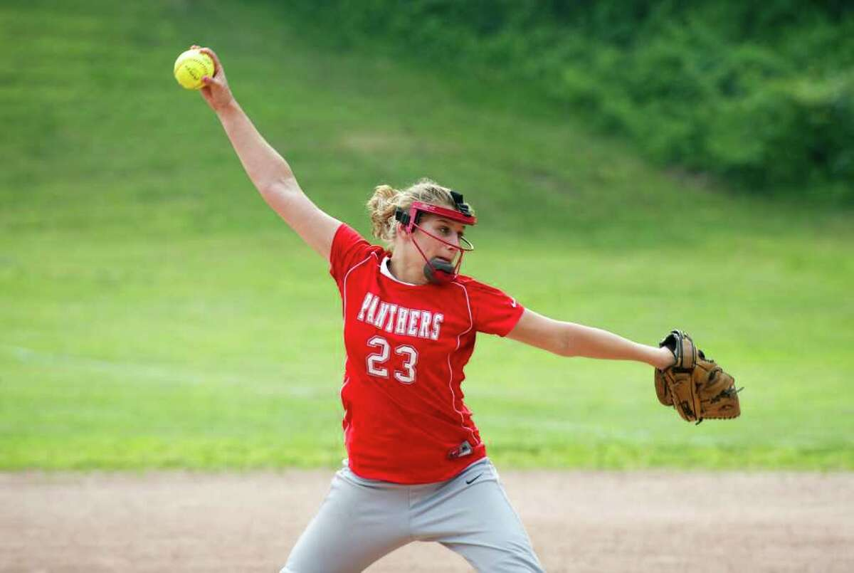 Pomperaug's Jordan Marquis throws as Westhill High School hosts Pomperaug in a Class LL softball game in Stamford, Conn., June 1, 2011.