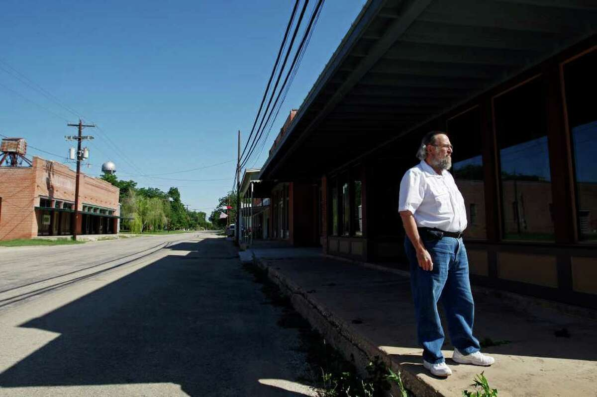 Former Austin and Washington insider Carlton Carl walks around downtown Martindale, just southeast of San Marcos. He bought most of the buildings in downtown Martindale and hopes to bring life to the town.