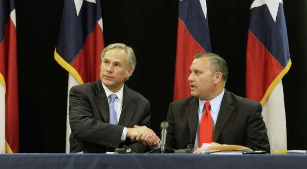 Texas Attorney General Greg Abbott (left) and Medina Valley Assistant Superintendent Chris Martinez after announcing plans to appeal an order banning prayer at graduation. Photo: John Davenport/Express-News