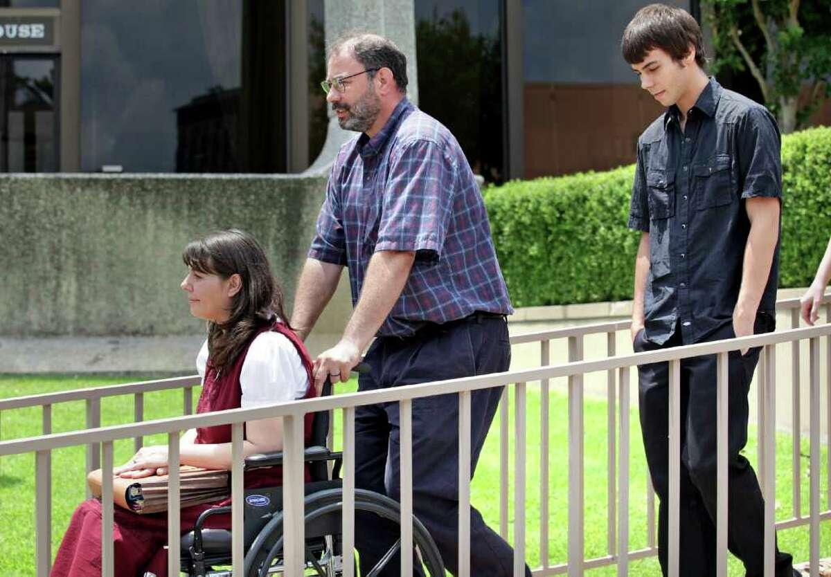Christa and Danny Schultz (left), whose son, Corwyn Schultz (right), will be graduating from Medina Valley High School this Saturday, leave the U.S. Courthouse in San Antonio, on Tuesday, May 31, 2011, after a hearing in which they are trying to ban the use of prayer during the graduation ceremonies.