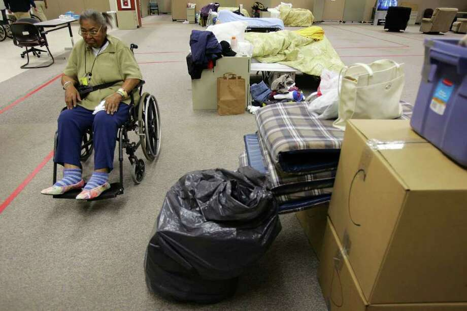 In the wake of Katrina, KellyUSA housed hundreds of evacuees. Some emergency officials feel new rules will overtax their ability to handle similar large-scale disasters. Photo: Express-News File Photo / SAN ANTONIO EXPRESS-NEWS