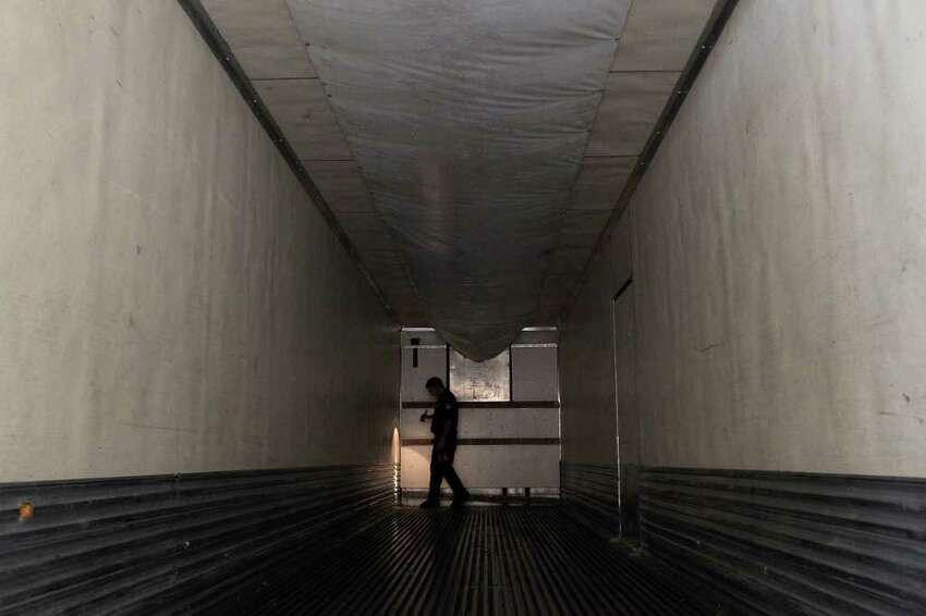 J.A. Flores, a Customs and Border Protection agriculture specialist, inspects the interior of a tractor-trailer after all of its produce has been removed at the Pharr-Reynosa International Bridge Port of Entry.