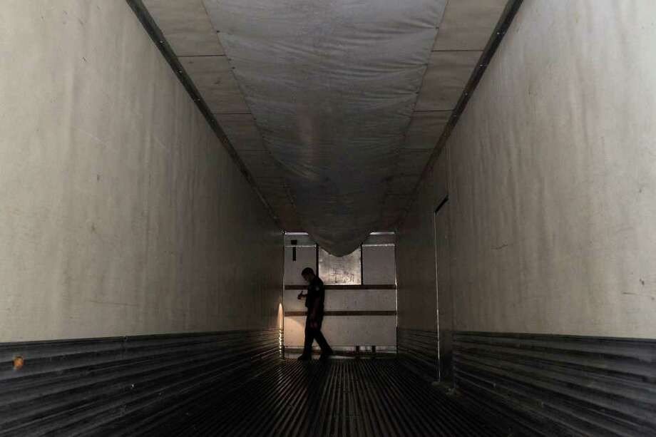 J.A. Flores, a Customs and Border Protection agriculture specialist, inspects the interior of a tractor-trailer after all of its produce has been removed at the Pharr-Reynosa International Bridge Port of Entry. Photo: Lisa Krantz/Express-News / SAN ANTONIO EXPRESS-NEWS