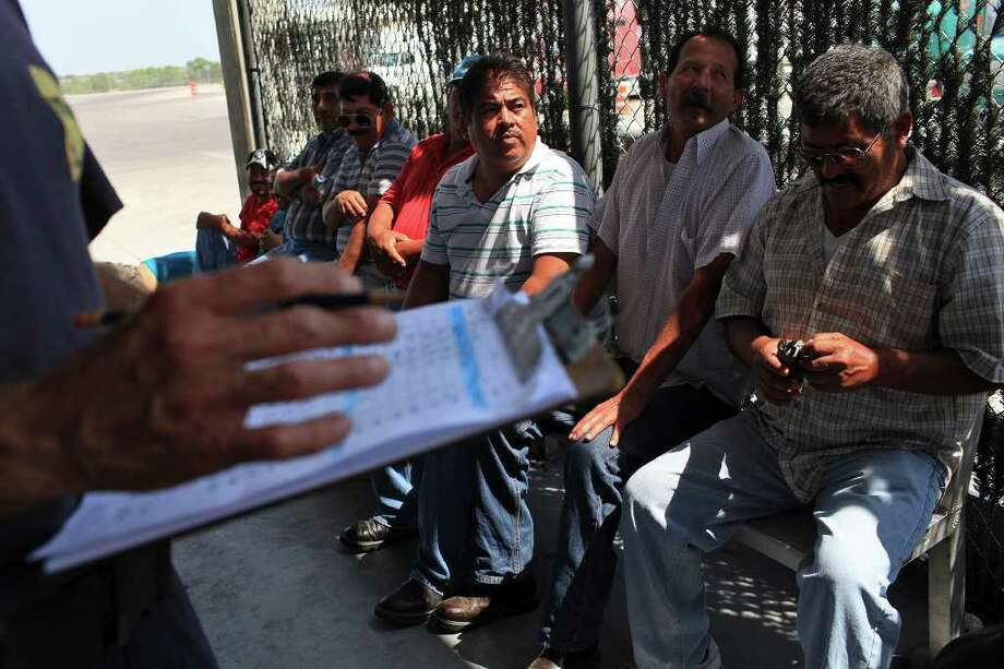 Truck drivers wait for their tractor-trailers and the produce they are transporting from Mexico to be inspected by Customs and Border Protection agriculture specialists at the Pharr-Reynosa International Bridge Port of Entry in April. Photo: Lisa Krantz/Express-News / SAN ANTONIO EXPRESS-NEWS